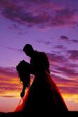 Silhouette couple dancing dip