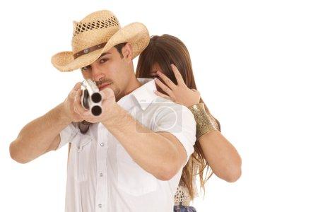 Woman behind cowboy with gun aming close