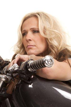 woman lay on motorcycle tank look forward