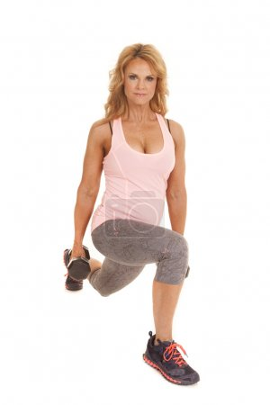 Mature woman lunge weights