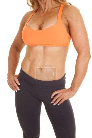 Woman orange bra hands hips body