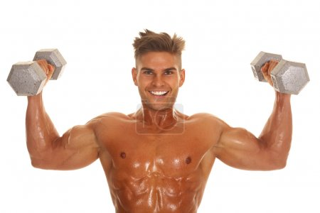 Photo for A man working out with weights with sweat on his body. - Royalty Free Image