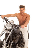man no shirt on motorcycle very serious