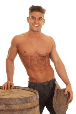 man strong no shirt barrel hat down