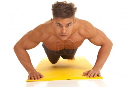 Photo for A man working out doing a push up on a fitness mat. - Royalty Free Image