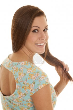 woman flower shirt hold back close smile