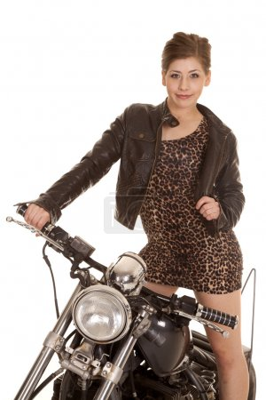 A woman in her leopard dress and leather jacket on...