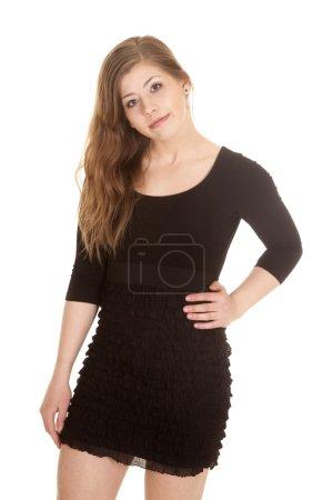 woman standing in black dress hand hip