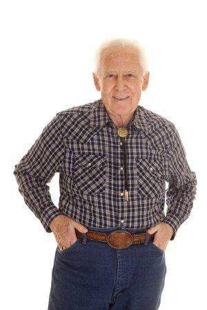 elderly man western attire hands pockets