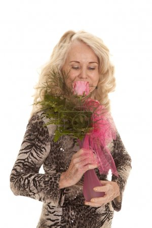 elderly woman smell roses