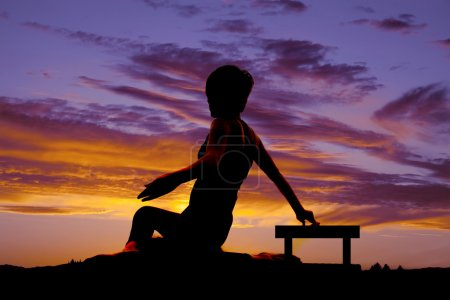 Silhouette woman sit twist sunset