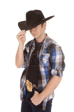 Cowboy with black hat one eye hidden