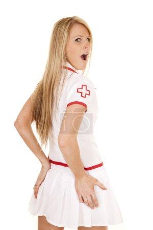 nurse back hands on butt