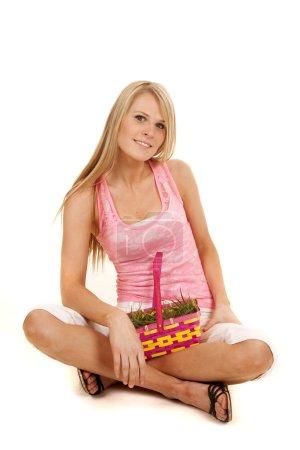woman pink tank top easter basket sit smile