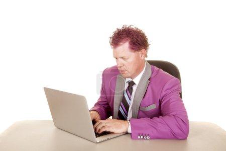 Man at laptop serious