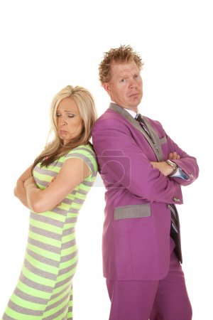 Man purple suit woman green dress standing sad