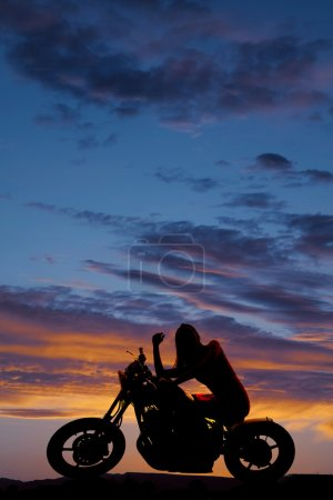 Silhouette woman on motorcycle