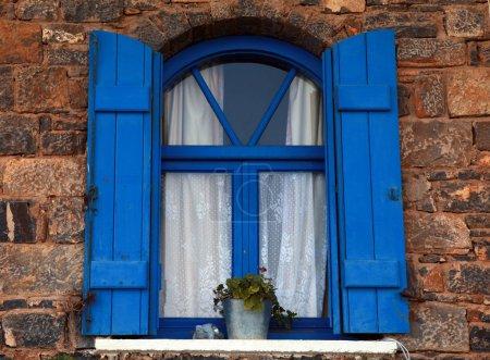 Blue window and shutter, Crete, Greece.
