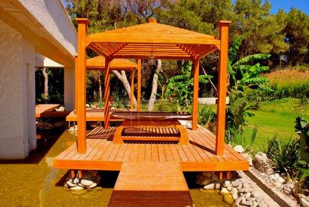 Wood pavilion in tropical garden on summer resort
