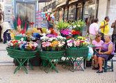 Outdoor fresh flower market on Lisbon main street(Portugal)