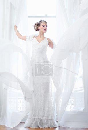 Beautiful Bride Standing By Open Window