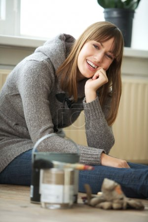 Photo for Renovating woman sitting and relaxing at home - Royalty Free Image