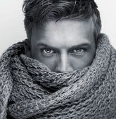 Portrait of a fashion model face covered by scarf