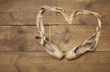 Two Ballet Shoes on Wooden Floor
