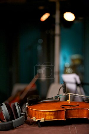 Photo for Violin laying on table inside music studio - Royalty Free Image