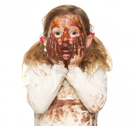 Photo for Portrait of a cute little girl covered in brown chocolate - Royalty Free Image