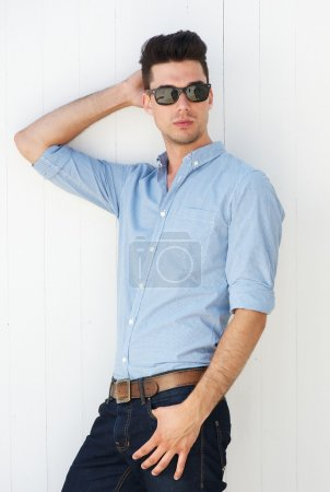 Photo for Portrait of a male fashion model posing with sunglasses outdoors - Royalty Free Image