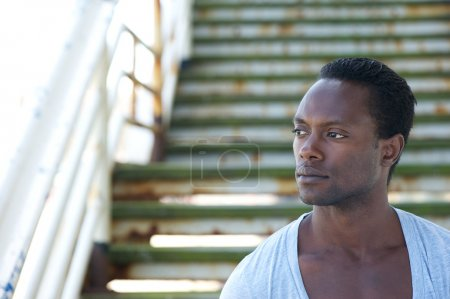 Closeup portrait of a handsome black male model looking away