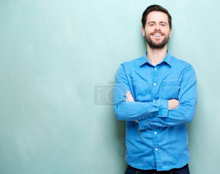 Photo for Closeup portrait of a happy young man smiling with arms crossed - Royalty Free Image