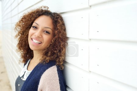 Portrait of a happy young attractive female smiling outdoors