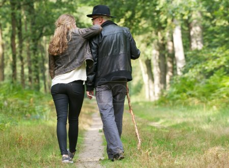 Photo for Portrait of a father and daughter enjoying a walk in the woods - Royalty Free Image