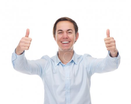Portrait of a handsome young man smiling with thumbs up in celebration