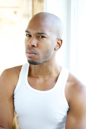Portrait of a good looking young black man in white shirt