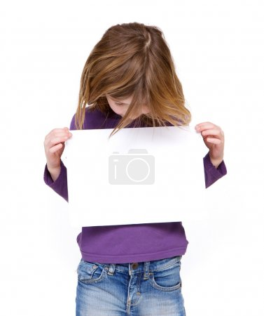 Young girl looking at blank sign