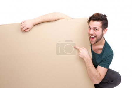 Man smiling pointing finger to empty space