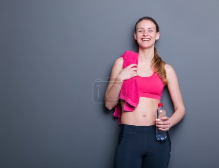 Smiling with towel and water bottle