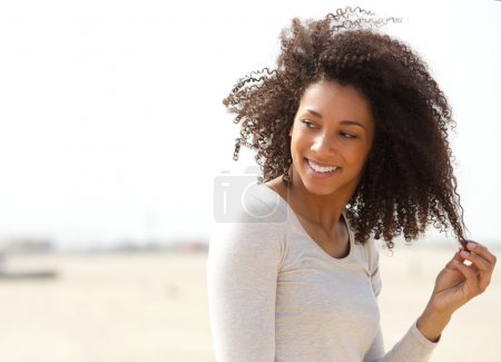 Young woman smiling with curly hair