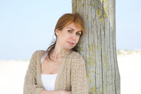 Photo for Close up portrait of a middle aged woman standing at the beach - Royalty Free Image