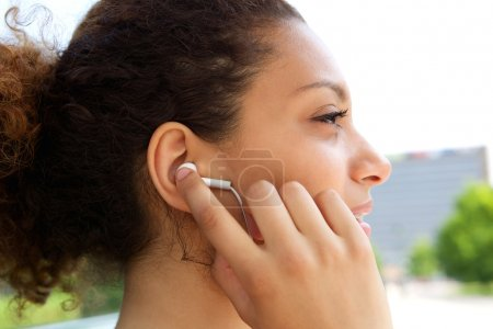 Woman with earphones in ears