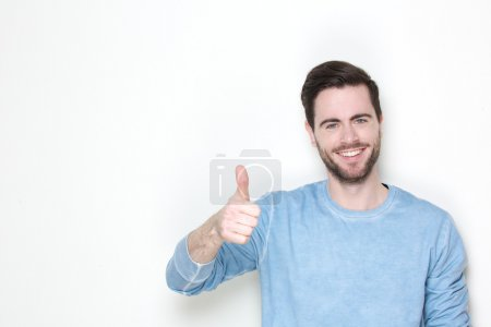 Man posing with thumbs up sign