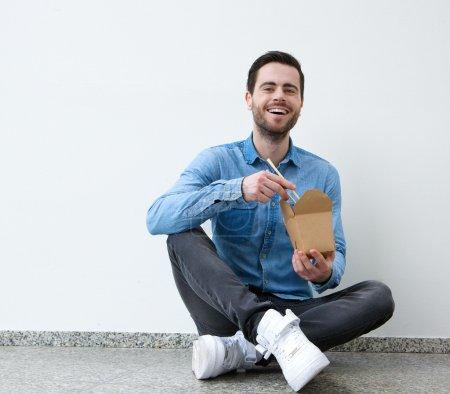 Young man enjoying chinese food