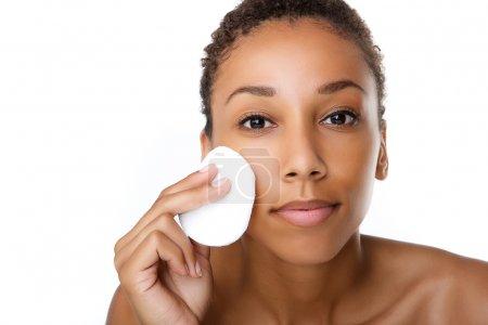Beautiful black woman removing make up