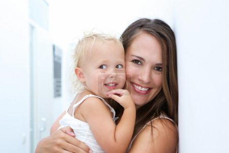 Photo for Close up portrait of a happy mother and baby daughter smiling together - Royalty Free Image