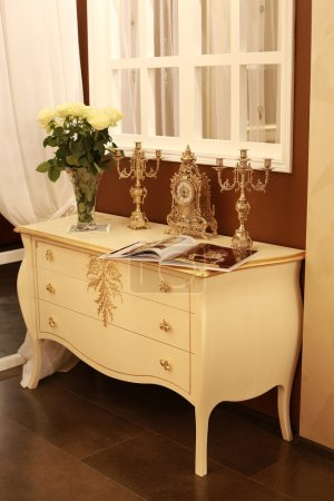 Chest of drawers with old clocks and chandeliers. Plush interior