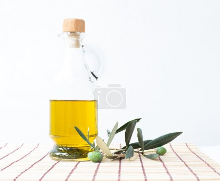 Glass bottle of olive oil.