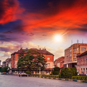 Old city wrapped by street at sunset
